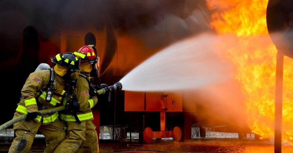 Fire fighters putting out a fire