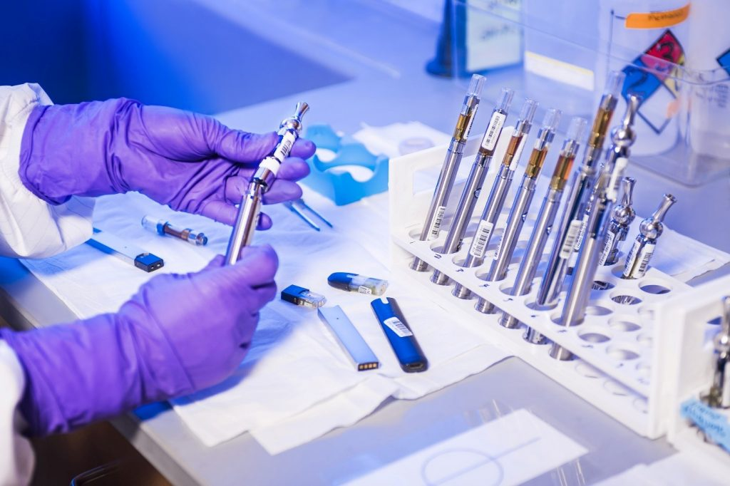 Laboratory technician working with vape pens containing lithium-ion batteries