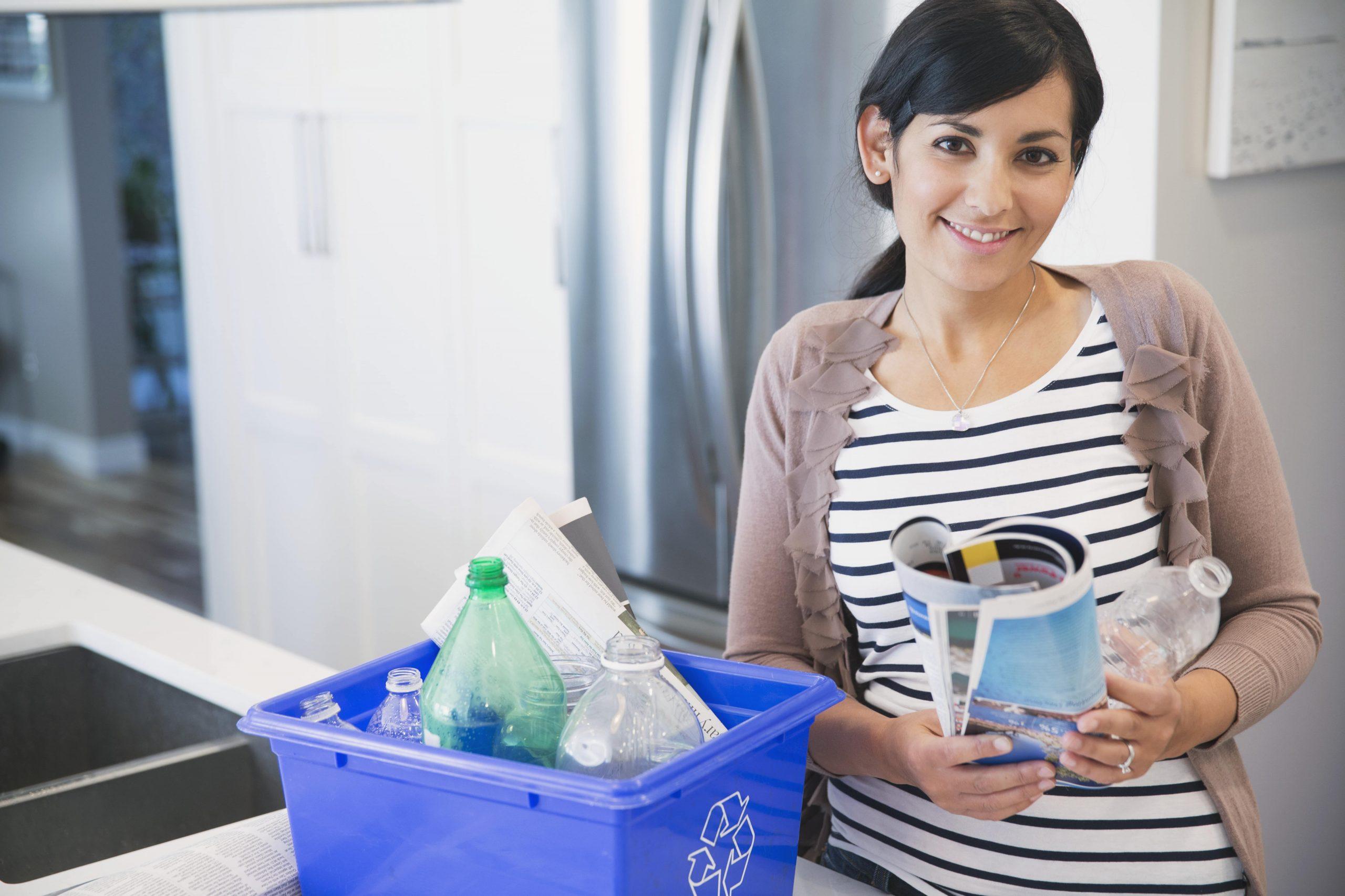 Woman sorting her recycling bin