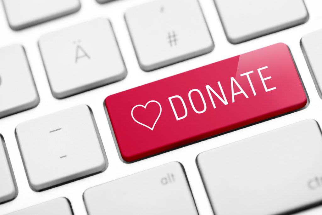 online donate key on keyboard to encourage recycling old electronics for reuse