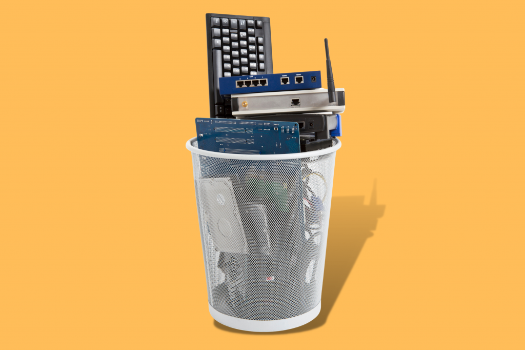 waste basket filled with electronic waste